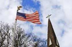 Church crosses and Fourth of July flags